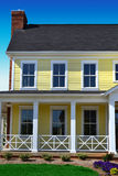 Yellow Cape Cod Home in the Springtime royalty free stock image