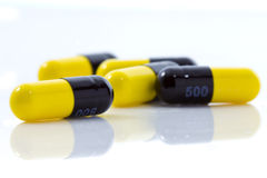 Yellow capsule Stock Photography
