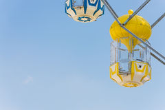 Yellow capsule seat of carousel in amusement park Royalty Free Stock Photography