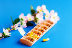 Yellow capsules with vitamins Stock Photos