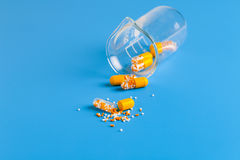Yellow capsules with vitamins Stock Images