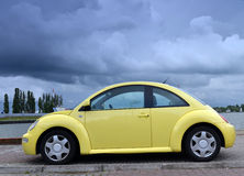 Yellow family car on road Royalty Free Stock Photo