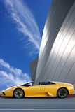 Yellow car. And modern building Royalty Free Stock Photos