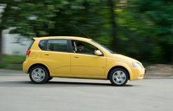 The Yellow Car. A yellow car with green background Royalty Free Stock Images