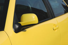 Yellow Car. Door and mirror Royalty Free Stock Photo