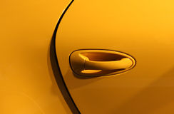 Yellow car background. Bright yellow car background closeup stock photo