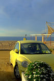 Yellow car on the beach Royalty Free Stock Image