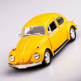 Yellow car, beetle on white Stock Images