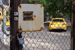 Padlock and code lock on background parked car Stock Photography