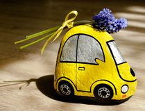 Yellow car carrying a flowers on the roof stock image