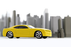 Yellow car in the city. Yellow toy car in the city Royalty Free Stock Photography