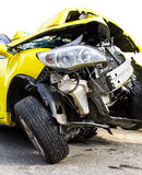 Yellow car crash Stock Images