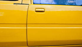 Yellow car door right Stock Photography