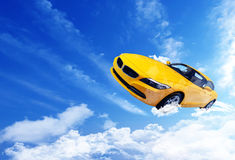 Yellow car. Flying over the clouds Royalty Free Stock Photos