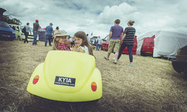 Yellow car and girls Royalty Free Stock Images
