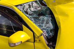 Yellow car glass damage. Close up of a Yellow car glass damage caused by accident Stock Images