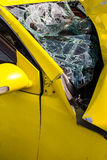 Yellow car glass damage. Close up of a Yellow car glass damage caused by accident Stock Photography