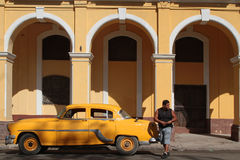 Yellow car and architecture Royalty Free Stock Photo