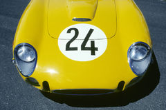 Yellow car hood. Front of sportscar in yellow with number 24 on hood Royalty Free Stock Images