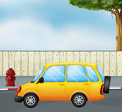 A yellow car Royalty Free Stock Images