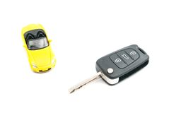 Yellow car and keys on white Stock Photos