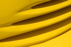 Yellow car lines. Detail of yellow track body. Lines and curves Royalty Free Stock Photo