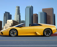 Yellow car in Los Angeles down. Town Royalty Free Stock Photography