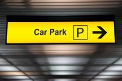 Yellow car park sign with arrow pointing to car parking zone. At airport terminal royalty free stock photography