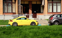 Yellow car parked outside. The house Royalty Free Stock Photography
