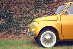 Yellow car parking. Parked yellow car on side of the road stock photography