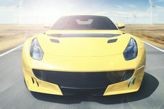 Yellow car is speeding on the highway Stock Images