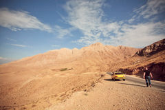 Yellow car stopped in mountaine valley Stock Photography