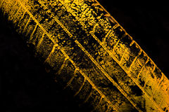Yellow car tire print. On black background Royalty Free Stock Images