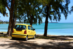 Yellow car on tropical beach Stock Photo