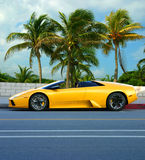 Yellow car on tropical island Stock Photo
