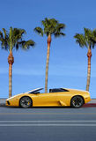 Yellow car on tropical island Royalty Free Stock Images