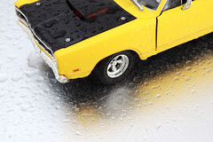 Yellow Car. On the water drop Royalty Free Stock Photography