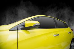 Yellow Car windows and side mirror. Yellow Car windows and side mirror  on black background. with smoke and fog Royalty Free Stock Images
