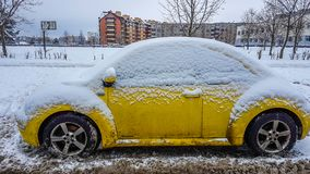Yellow car in winter. Covered by snow Stock Image