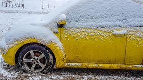 Yellow car in winter closeup. Yellow car in winter covered by snow Royalty Free Stock Photos
