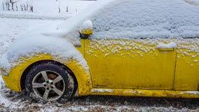 Yellow car in winter closeup Royalty Free Stock Photos