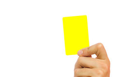 Yellow card. Hand holding a yellow card isolated on white background Stock Images