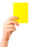 Yellow card in hand Stock Photos