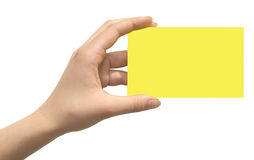 Yellow card in a hand Royalty Free Stock Image