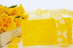 Yellow card and yellow roses Royalty Free Stock Photo