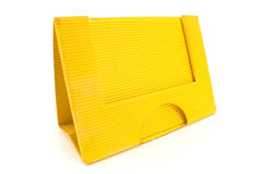 Yellow cardboard paper holder Royalty Free Stock Photos