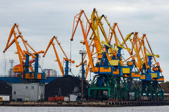 Yellow cargo cranes. In the port of Riga, Europe stock image