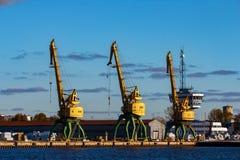 Yellow cargo cranes. In the port of Riga, Europe Stock Photos