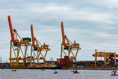 Yellow cargo cranes. In the port of Riga, Europe royalty free stock photography