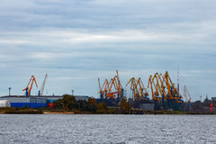Yellow cargo cranes. In the port of Riga, Europe stock images